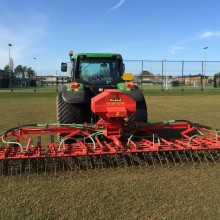 Grass harrows and air seeder